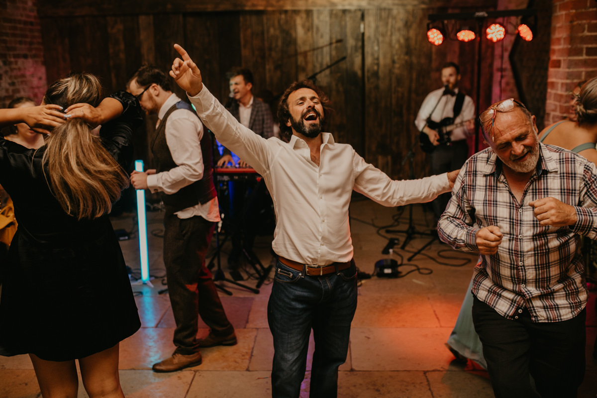 guests dance during the Shustoke Barn wedding reception
