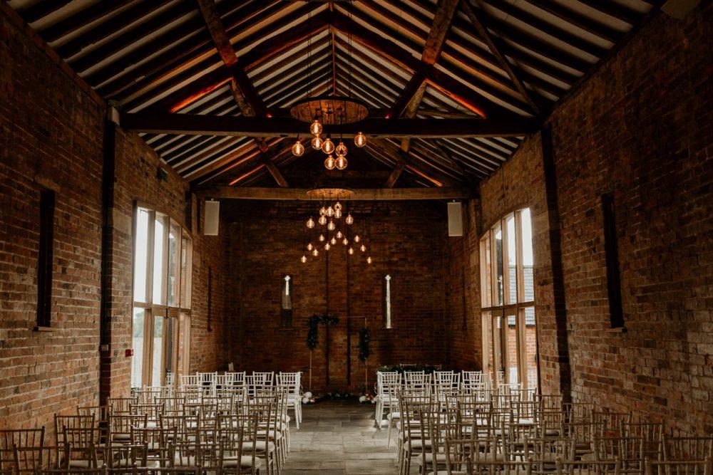 wedding ceremony barn area at mickleton hills farm wedding venue
