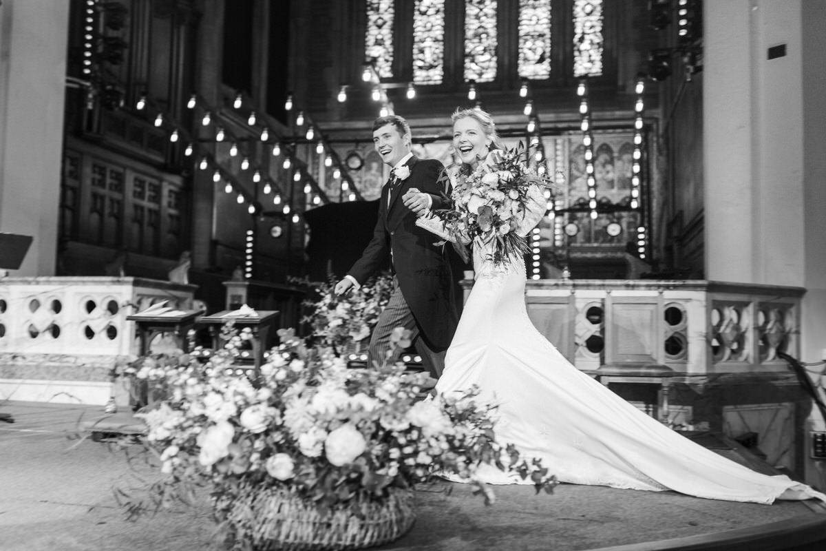 bride and groom happy after the wedding ceremony for a wedding timeline breakdown