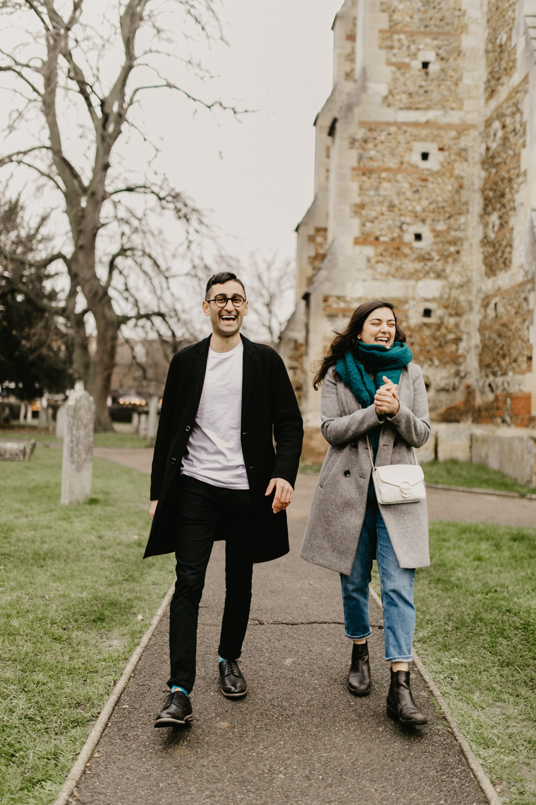 couple walking happily during their engagement shoot in 2020