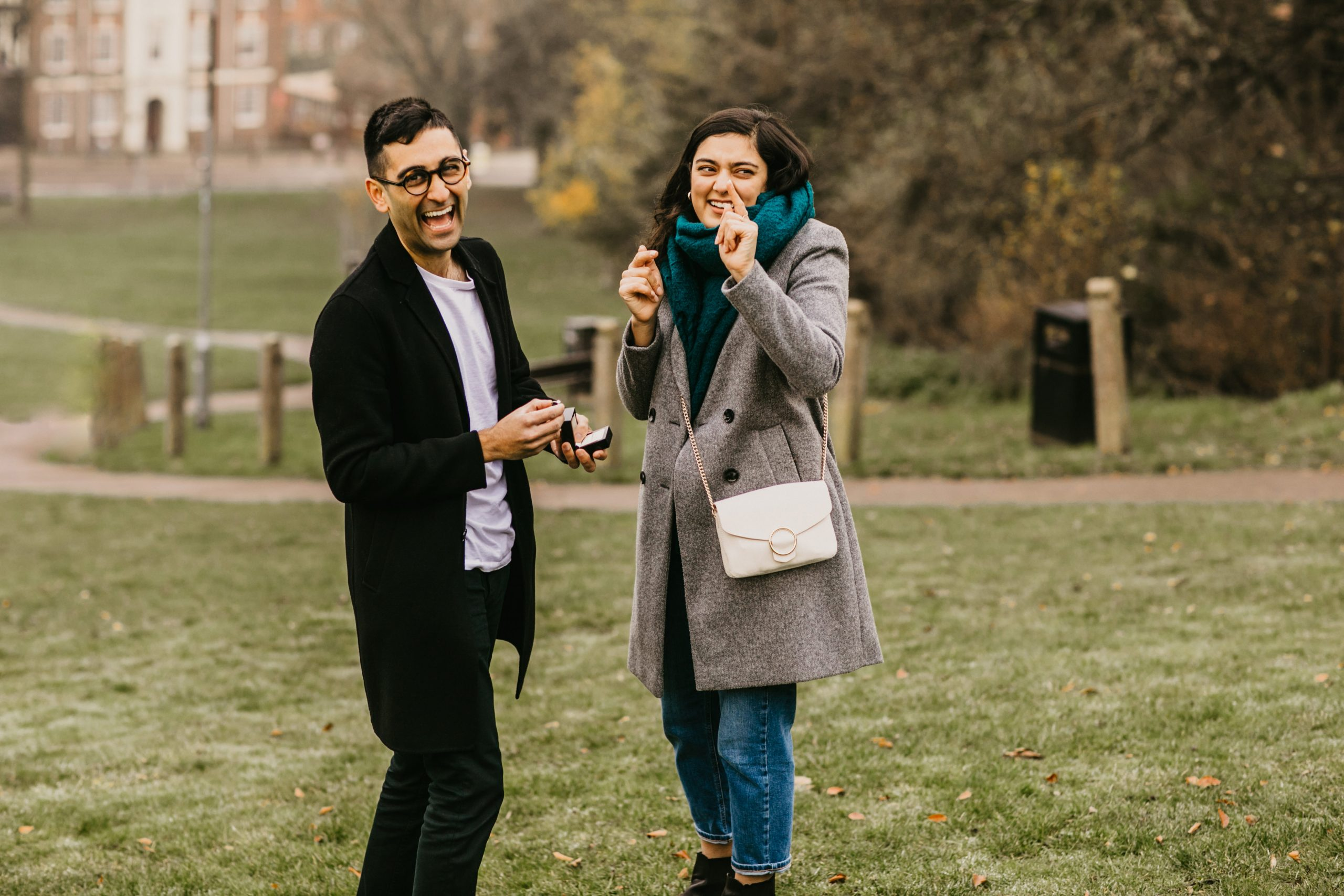 girl surprised by the camera during the proposal