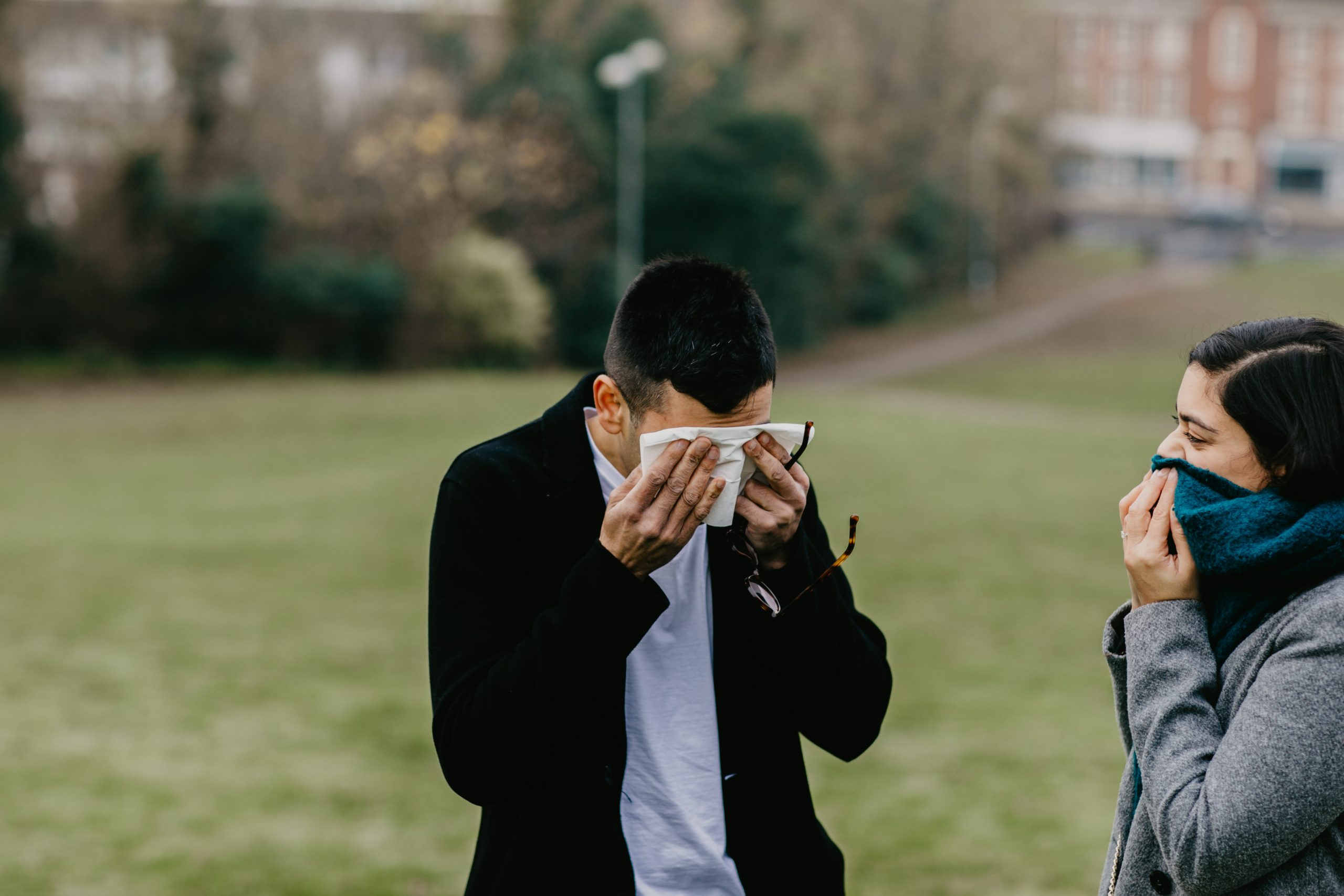 guy wiping down tears after the proposal of his girlfriend